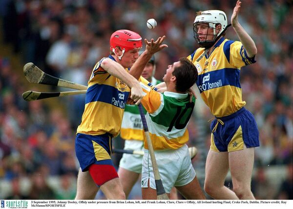 Johnny Dooley, Offaly under pressure from Brian Lohan and Frank Lohan, Clare. Picture: Ray McManus/SPORTSFILE