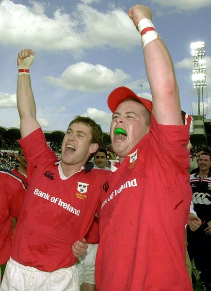 Munster rugby team players Jeremy Staunton and John O'Neill salute the fans. Picture: AP Photo/Bob Edme