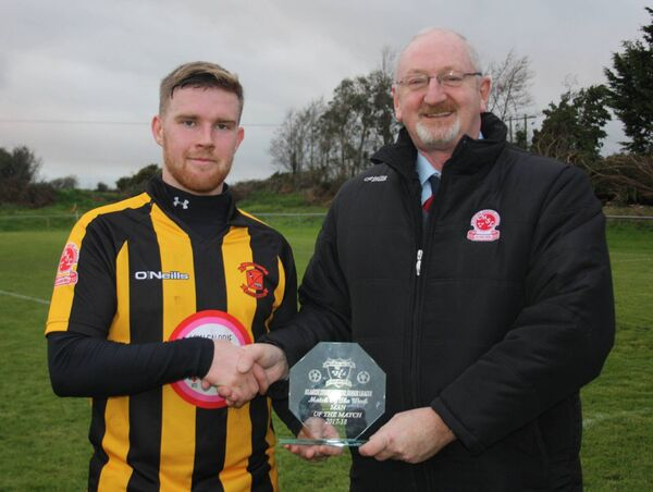 Pat Quinn, Munster Senior League, presents the Beamish Stout Player of the Week award to Jason Abbott, Cobh Wanderers after their win over Ringmahon Rangers.
