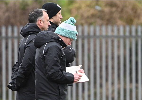 City assistant manager Joe Gamble, manager Neale Fenn and coach Alan Bennett look on as City play against Cobh Ramblers during their pre-season friendly in Mayfield.