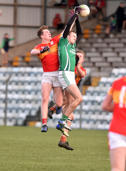 Ballincolig's Evan Cooke goes high with  Éire Óg brothers Hugh and Jack Murphy. Picture: Eddie O'Hare