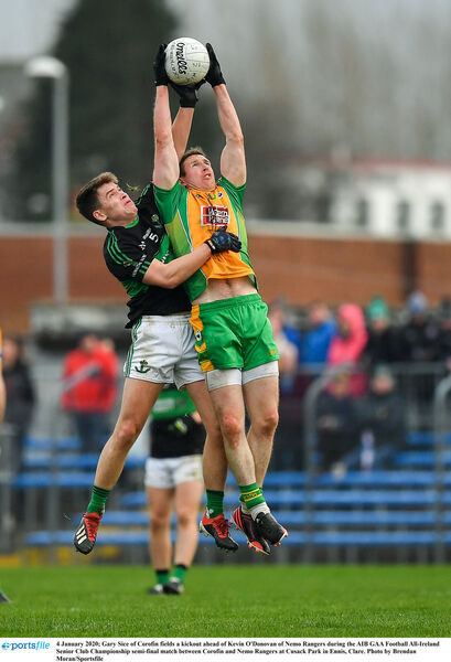 Gary Sice of Corofin fields a kickout ahead of Kevin O'Donovan of Nemo Rangers during the AIB GAA Football All-Ireland Senior Club Championship semi-final match between Corofin and Nemo Rangers at Cusack Park in Ennis, Clare. Photo by Brendan Moran/Sportsfile