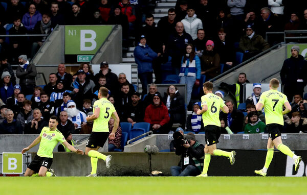 Sheffield United's John Egan celebrates scoring his side's first goal of the before VAR rules it out for a hand ball away to Brighton. Picture: Gareth Fuller/PA Wire.