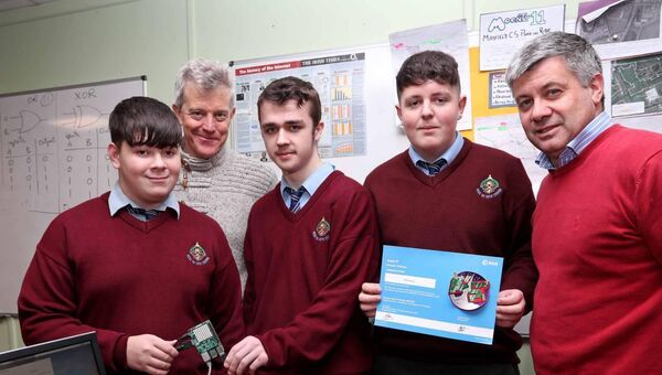 Liam Begley, Computer Science teacher and Kieran Golden, principal with Conor Lucey, Shane Cunningham and Sean Barrett, 5th year Computer Science students with their mini computer, Raspberry PI.	Picture: Jim Coughlan