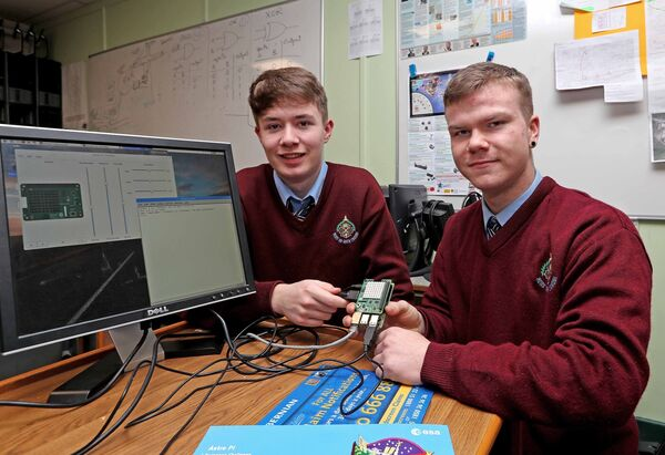 Fionn Power and Ryan Myers, 5th year Computer Science students with their mini computer, Raspberry PI.Picture: Jim Coughlan