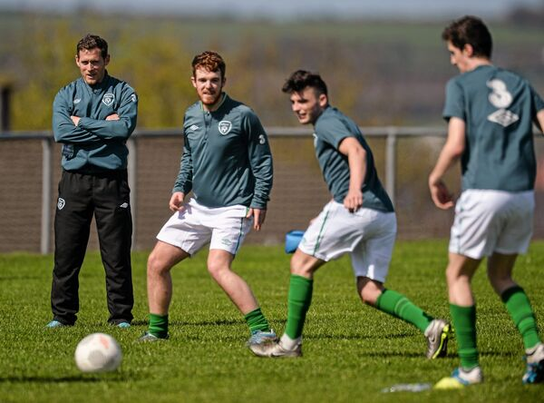 Joe Gamble looks during the warm up of the members of the Colleges & Universities National Team. Picture: David Maher/SPORTSFILE