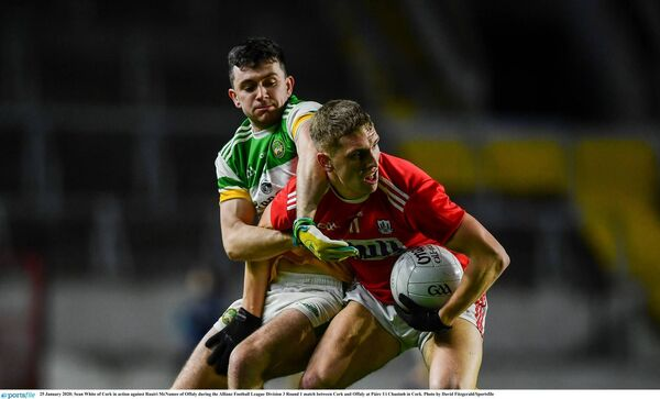 Sean White of Cork holds off Ruairí McNamee of Offaly at Páirc Uí Chaoimh. Picture: David Fitzgerald/Sportsfile