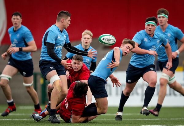 Ireland U20's Jack Crowley is tackled by Eoghan Clarke of Munster Development. Picture: Oisin Keniry