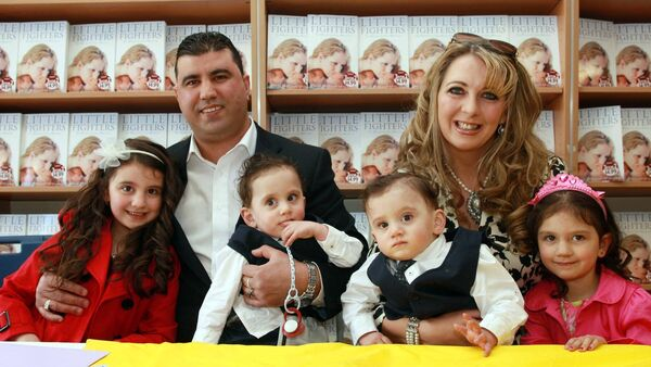 Pictured at the launch of her 'Little Fighters' book, mum Angie Benhaffaf, husband Azzedine, daughters Malika and Iman and Hassan and Hussein. PictureL Conor Healy Photography