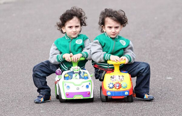 GROWING UP: Hassan and Hussein Benhaffaf, out in their Park on their push cars.Picture: Jim Coughlan.