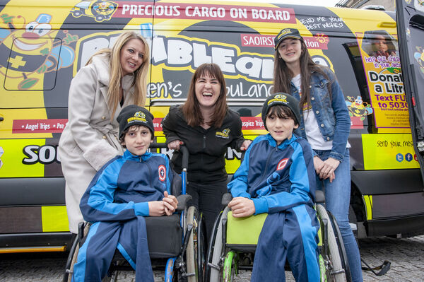 PICTURED THIS MONTH: Jennifer Kissane (centre) of BUMBLEance with the Benhaffaf family, mum Angie, twins Hassan and Hussein and sister Malika at the launch of BUMBLEance 12. Picture: Brian Lougheed