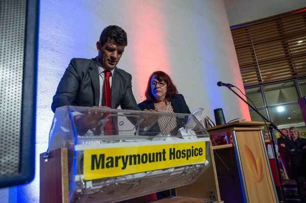 Donnacha O'Callaghan pulls the winning ticket from the drum at the Light up a life Marymount fundraiser event on Dec 1 Pic. John Allen/Provision