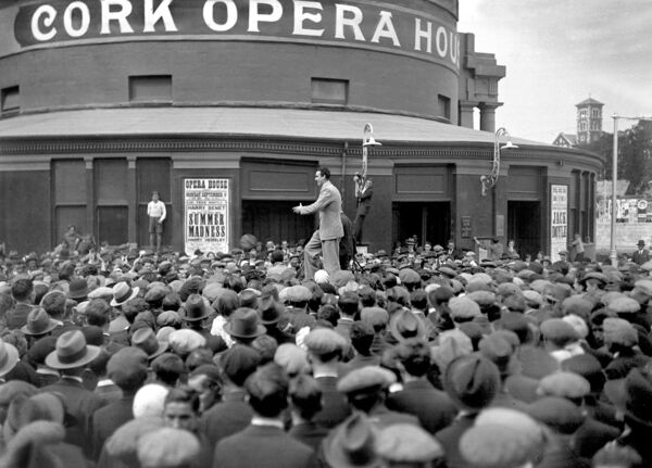 The Opera House in its former glory before it was devastated by the fire in 1955. Jack Doyle entertains fans in Emmet Place who were unable to get tickets for his concert at Cork Opera House in September 1933.