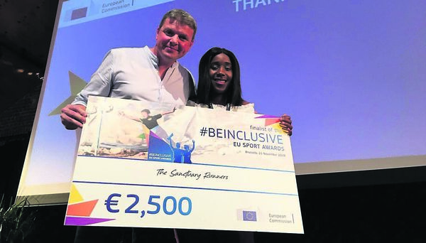 Graham Clifford, and Yolanda Mhene, Sanctuary Runners, in Brussels at the #BeInclusive Social Inclusion in Sport Awards held by the European Commission.
