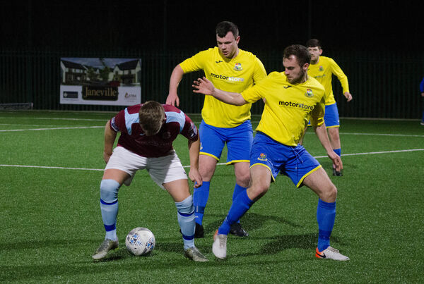 Cian Leonard of Cobh Ramblers battles Carrigaline. Picture: Howard Crowdy