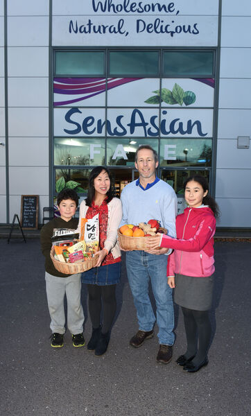 May O'Donovan with husband John and children John Jnr and Sophie at SensAsian, Link Road, Ballincollig, Co Cork.Pic; Larry Cummins