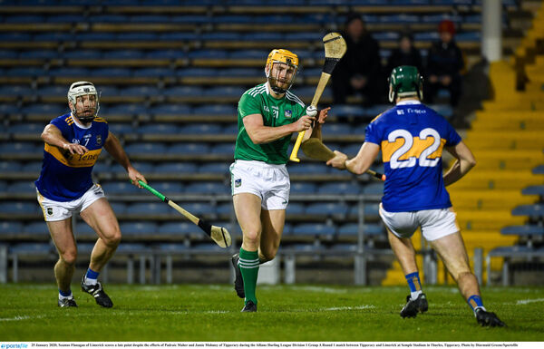Seamus Flanagan of Limerick scores a late point despite the efforts of Pádraic Maher and Jamie Moloney of Tipperary last weekend. Picture: Diarmuid Greene/Sportsfile