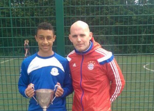 Adam Idah pictured with Douglas CS soccer coach Kevin Ronayne