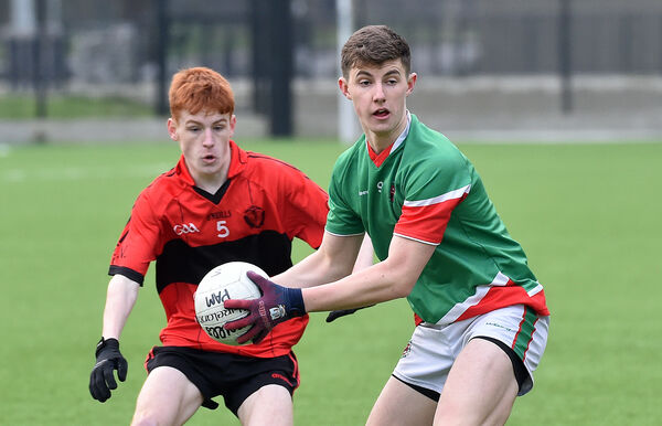 Conor Corbett Patrician Academy holding off Liam Lyons, Colaiste an Spraoid Naomh during their U19 B football semi-final at the Pairc Ui chaoimh 4G pitch. Picture Dan Linehan