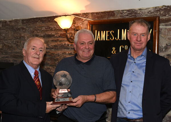 Paul Crowley receives his Distinguished Service Award from Denis O'Driscoll, Cork AUL, with Jim Cashman, Heineken Ireland. Picture: Larry Cummins