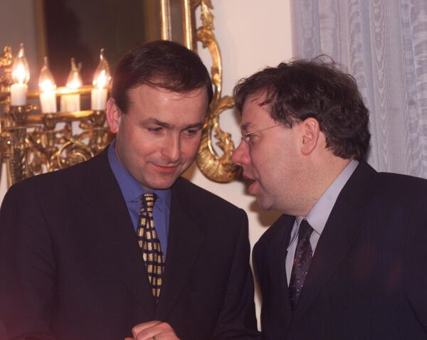 Brian Cowen has a word with his successor Micheál Martin.