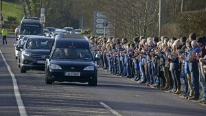 'Sleep tight Cam'; Hundreds line the roads as 'darling son' Cameron Blair is laid to rest