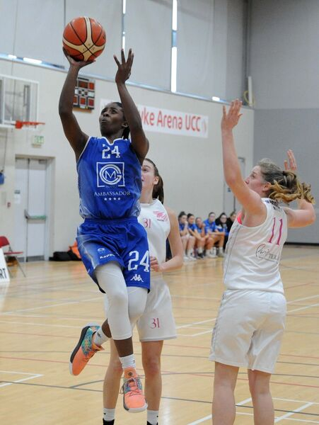 Team Ambassador UCC Glanmire's Shrita Parker shooting a basket. Picture: Denis Minihane.