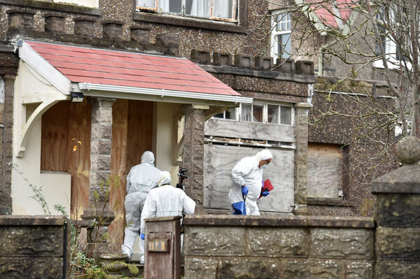 Members of the Garda forensic team at Castlegreina House on the Boreenmanna Road in Cork where the body of a man was discovered. Picture Dan Linehan