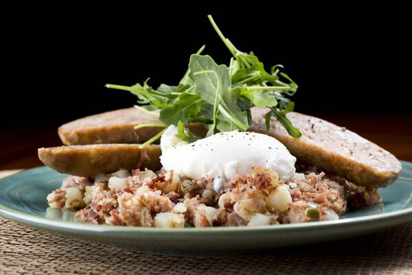 Hash can be so versatile, this contains Pork Sausage - with Poached Egg over Corn Beef Hash. Picture: Stock