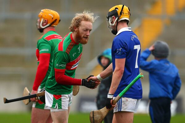 Fr O'Neill's Podge Butler shakes hands with Tooreen's David Kenny after the game. Pic; Tom O'Hanlon