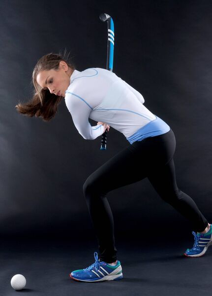 Cliodhna Sargent wearing a white top and black/ blue leggings from Queen B.