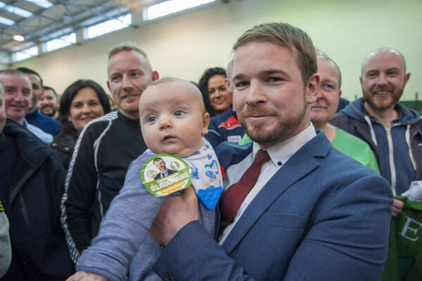 Sinn Fein's Donnchadh Ó Laoghaire pictured celebrating with son Fiach (4mths) and partner Eimear, as the first TD to be elected to the 33rd Dáil as he tops the poll in Cork South Central, Nemo GAA complex, Cork.Pic Daragh Mc Sweeney/Provision