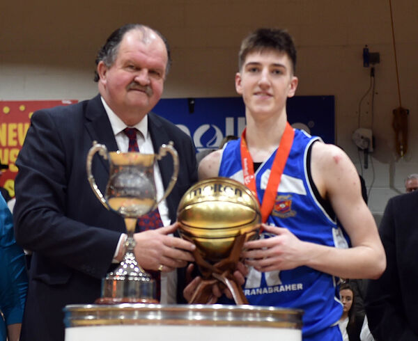 Neptune's Cian Heaphy recieves the MVP award from Bernard O'Byrne after the win over Kubs in the Hula Hoops National under 18 mens final at the Basketball Arena, TallaghtPicture: Eddie O'Hare