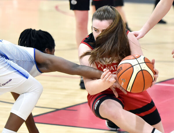 Fr Mathew's Amy Murphy is tackled by Ambassador UCC Glanmire's Shrita Parker in their clash on Saturday. Picture: Eddie O'Hare