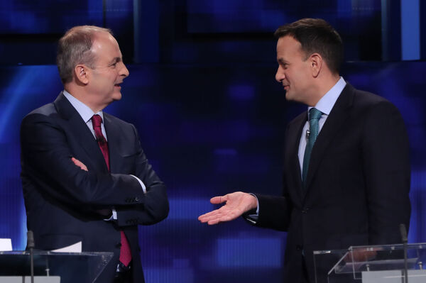 Fianna Fail leader Micheal Martin nad, Fine Gael leader Leo Varadkar during a commercial break in the final TV leaders' debate at the RTE studios in Donnybrook, Dublin. Pic: Niall Carson/PA Wire