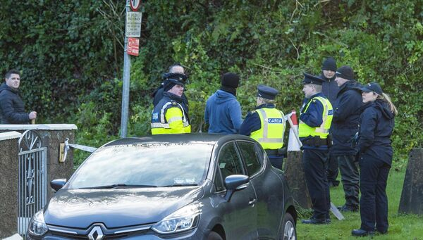 Garda members taking part in a search of the undergrowth on the cliff face above O'Donovan Rossa, Road, Cork in connection with the death of CIT student Cameron Blair who was stabbed at the Bandon Road, Cork. Picture Dan Linehan