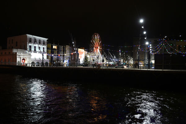 The Ferris wheel and Christmas lights on Grand Parade Cork, beside the River Lee, as part of the Cork Christmas Celebration.Pic; Larry Cummins