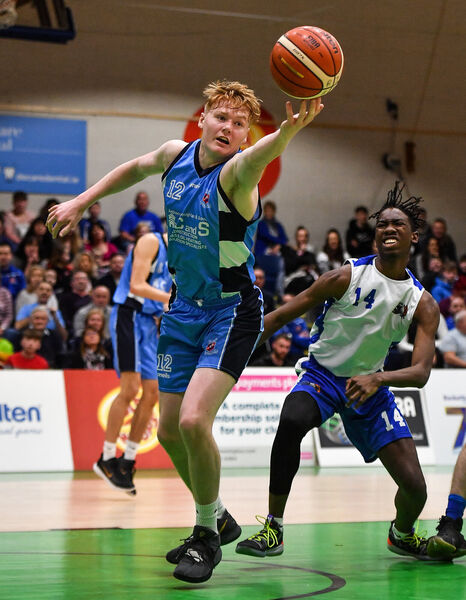 Eoghan Sheehan of Neptune reaches for a loose ball ahead of Ryan Kingi of Belfast Star during the Hula Hoops U18 Men's National Cup Final between Neptune and Belfast Star at the National Basketball Arena in Tallaght, Dublin. Photo by Brendan Moran/Sportsfile *** NO REPRODUCTION FEE ***