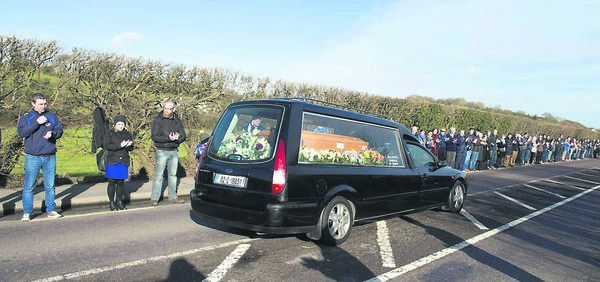 The funeral cortege of Cameron Blair passes Bandon Rugby Club flanked by club membersPic Michael Mac Sweeney/Provision