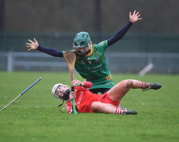 Haley Ryan, Cork hits the turf after a challenge from Kristina Troy, Meath in wet and blustery weather conditions on Saturday. Picture: Larry Cummins.