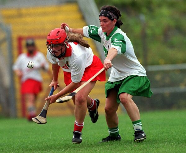 Mary O'Connor wins possession from Limerick's Liz Leonard at Páirc Uí Rinn in 1999. Picture: Des Barry