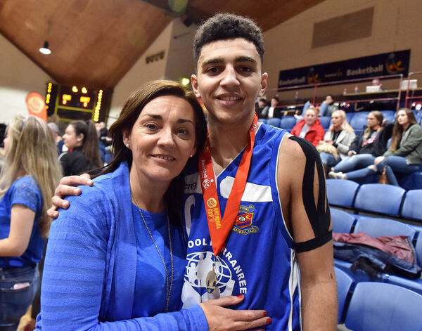 29th January 2017....... BFG Neptune's Sean Jenkins with his mother Angeline Myers after defeating Kubs in the Hula Hoops under 20 mens national cup final at the Basketball Arena, Tallaght yesterdayPicture: Eddie O'Hare