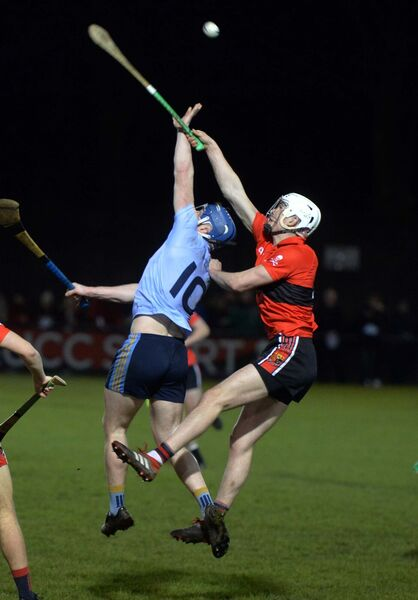 UCC's David Griffin and UCD's Eoin Foley going high for the ball in the Fitzgibbon Cup at the Mardyke. Picture: Denis Minihane.