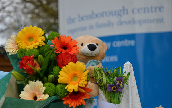 Flowers and toys seen on the railings of Bessborough House Centre during the recent candlelight vigil. Picture: Howard Crowdy