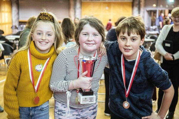 Over all winners 5th class students, Suairní Burke and Meabh Songhurst and Milo Heffernan of Muinefliuch NS, Macroom react to their win.
