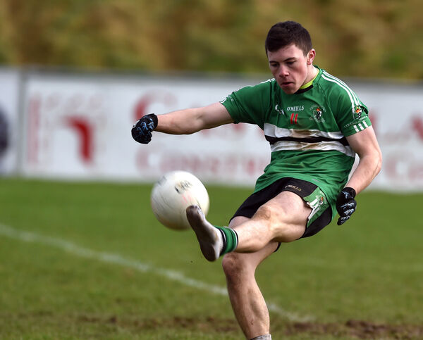 Bootless but deadly! Coláiste Chríost Rí's Mark Cronin kicks over a point minus his boot against Tralee CBS in the Corn Uí Mhuirí semi-final in 2017. Picture: Eddie O'Hare