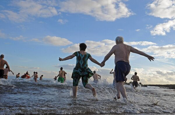 Running into the cold water for the Christmas Day swim at Myrtleville, Co. Cork. Picture Denis Minihane.