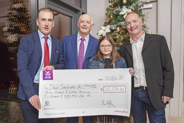 Pictured with cyclist Sean Kelly are Liam Ahern, President of Down Syndrome Ireland, Laura Ahern from Glanmire, and Paul Sheridan, founder and organiser, at the Tour de Munster 2019 cheque presentation at Clayton Hotel Silver Springs in Cork on Saturday, November 30. Pic: Diane Cusack
