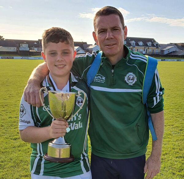 Ballincollig U13 manager Kevin Kirstein and his son Daniel with the Bill O'Keeffe Memorial Cup.