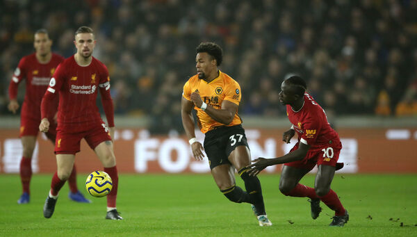 Wolves' Adama Traore breaks from Liverpool's Sadio Mané (right) during their Premier League match at Molineux. Mané picked up an injury to join the list of injured first team players out for Liverpool, that no doubt added to Jurgen Klopp's frustration at having to replay their FA Cup fourth round tie during the league's mid-winter break. 	Picture: Nick Potts/PA Wire